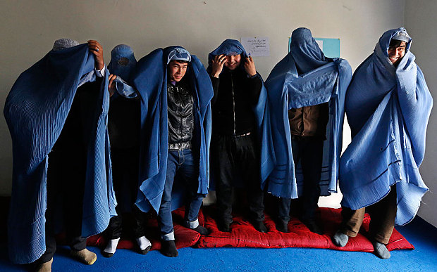men in burqas, not popular in Afghanistan, I wonder why