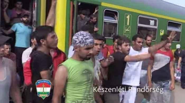 Germany. Muslim migrants  being threatening. Note the female presence.