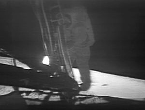 Neil Armstrong, touching down on the Moon -an image I'll never forget